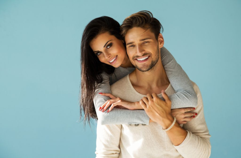 Young Couple hugging and Smiling - Veneers Manhattan New York