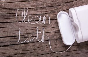 "The words ""clean teeth"" spelled out in dental floss"