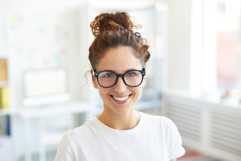 Woman Smiling - Dental Bridges, NYC
